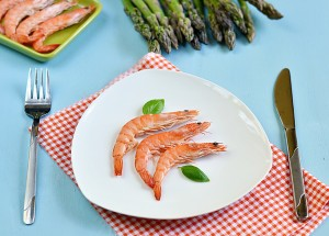 King shrimps with basil leaves in a white plate