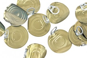 Tin can lids with opener on white