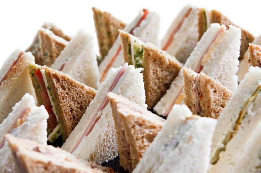 Cut platter of mixed  sandwich triangles