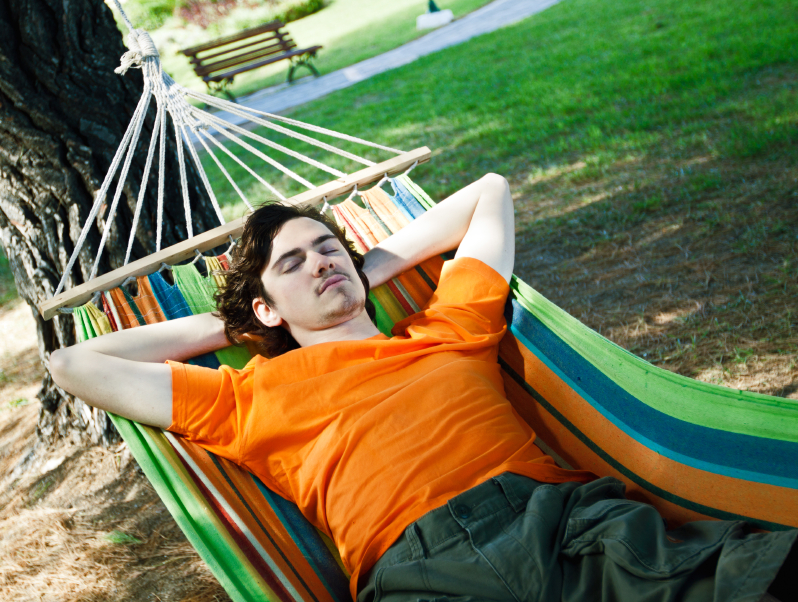 The young man has a rest in a hammock