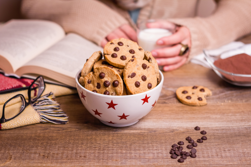 Chocolate chip cookies on stars bowl over a table