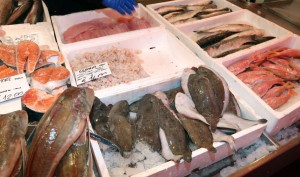 fresh fish on sale in fish market stall pesce