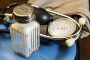 salt shaker and blood pressure gauge on plate