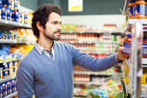 Attractive man shopping in a supermarket sanzioni