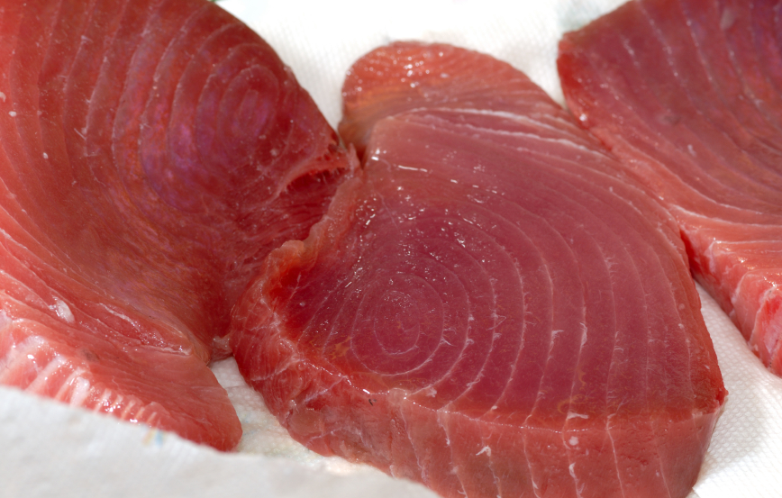 thick succulent tuna steaks being prepared for cooking