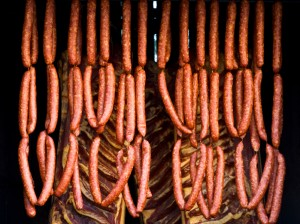 sausages and bacon being smoked