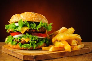 still life with traditional hamburger and french fries