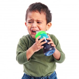 Upset Sad Toddler Crying while Drinking from a Sippy Cup