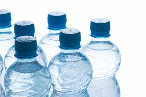 Bottles with water on white background